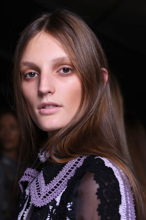 "**ERDEM** Could ""tea stained eyes"" take off? Hmm. Makeup legend Val Garland for NARS Cosmetics set the trend at Erdem, which is always about a spooky beauty look. We love the glossy locks, though. Very wearable."