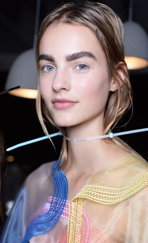 "**CHRISTOPHER KANE** Bushy ""feral brows"" trended at Christopher Kane where models showcased a raw and undone beauty look by NARS. It seems bold brows are going nowhere…"