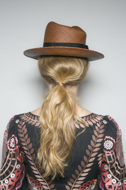 **TEMPERLEY** The low texturised ponytails at Temperley oozed a flirtatious confidence. Antonio Corral Calero, Global Moroccanoil Ambassador, used Moroccanoil Root Boost to give grip and volume before sweeping the hair up and then dishevelling it with his fingers.