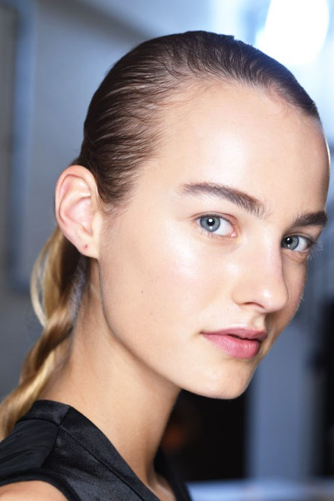 "**J.W. ANDERSON** Minimal makeup retuned to London Fashion Week at J.W. Anderson, where NARS products were used to achieve perfect skin and ""bring back the brow bone"". Will this spur-on the return of arches in place of straight, statement brows? It's baby steps."
