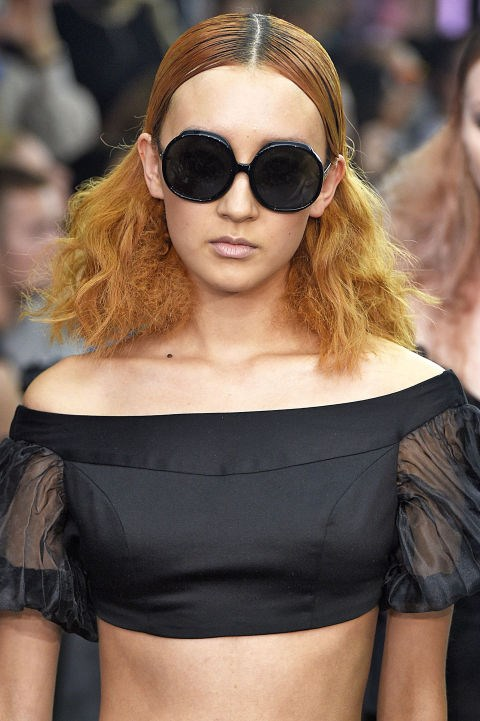**PPQ** Hair artists from the Wella Professionals Colour Club gave models statement hair hues at PPQ. The hairstyles featured crimped, fairy floss-textured mid-lengths with slick centre-partings to create a chic contrast.