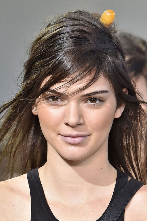 "**MICHAEL KORS** Models including Kendall Jenner showcased a fresh and radiant glow here. ""The look is about bronze, matte skin. A believable warmth is created with Michael Kors Bronzer in Glow, a universal shade,"" said makeup artist Dick Page. We want it!"