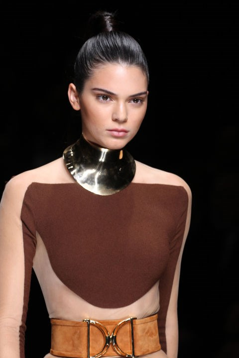**BALMAIN** Kendall Jenner modelled the slick look at Balmain featuring high ponytails, bound with Balmain Hair extensions. Makeup was suitably pared-back but featured strong brows and contouring.