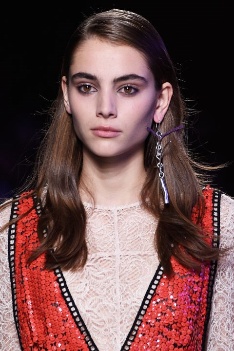 "**EMILIO PUCCI** Inspired by 90s grunge, makeup artist Lucia Pieroni for MAC gave girls radiant skin against a ""worn in for days"" eye makeup look, with kohl liner applied on the top and bottom waterlines of the eyes. The hair was side parted with flat roots and a glossy texture."