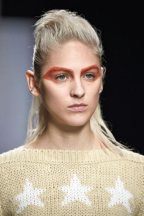 **MAX MARA** Makeup artist Tom Pecheux transformed the models' brows into amazing graphic shapes of orange and green for a bold beauty look at Max Mara. *Love* this!