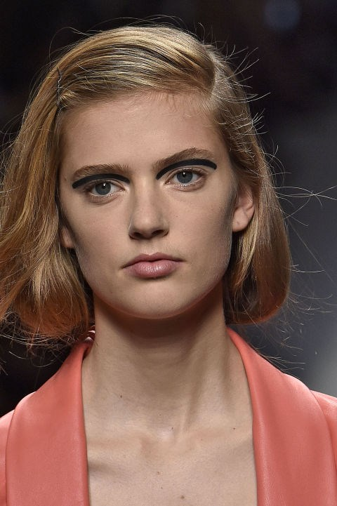 **FENDI** At Fendi in Milan, hairstylist Sam McKnight pinned the models' hair into faux bobs with deep side partings. Makeup was minimal save for bold floating eyeliner by makeup artist Peter Philips. Well, that's one way to achieve a wide-eyed look.
