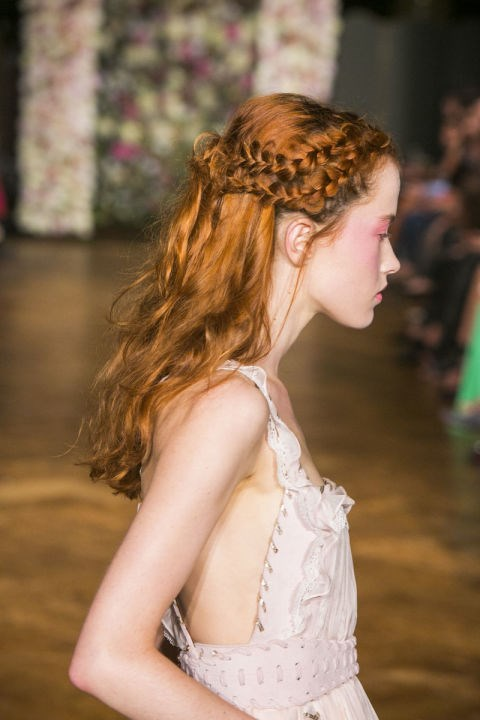 **KRISTIAN AADNEVIK** Antonio Corral Calero, Global Moroccanoil Ambassador, created these enchanting multi-braided hairstyles. The two braids at either side of the models head overlapped at the back and were secured by knotting the hair four times, with the ends left loosely hanging.