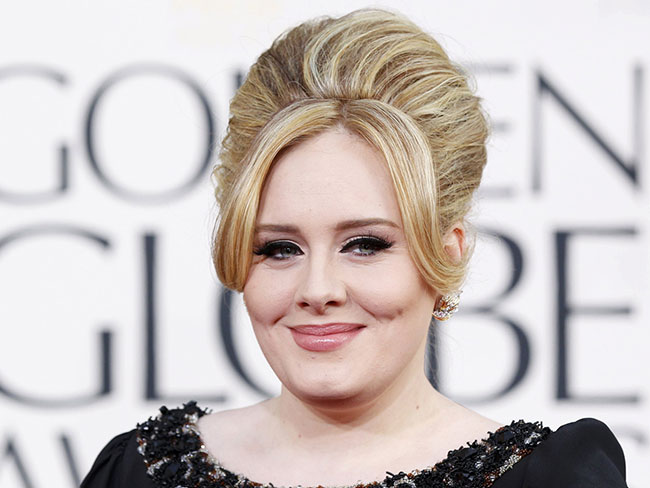 The internet's losing its damn mind over Adele's hot AF bodyguard