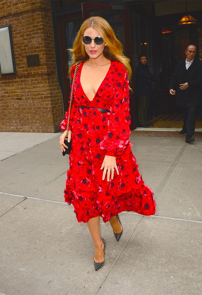 We will never EVER tire of looking at Blake Lively in her perfect outfits. Case in point: this 3D poppy dress and those rock n roll studded heels. Obsessed.