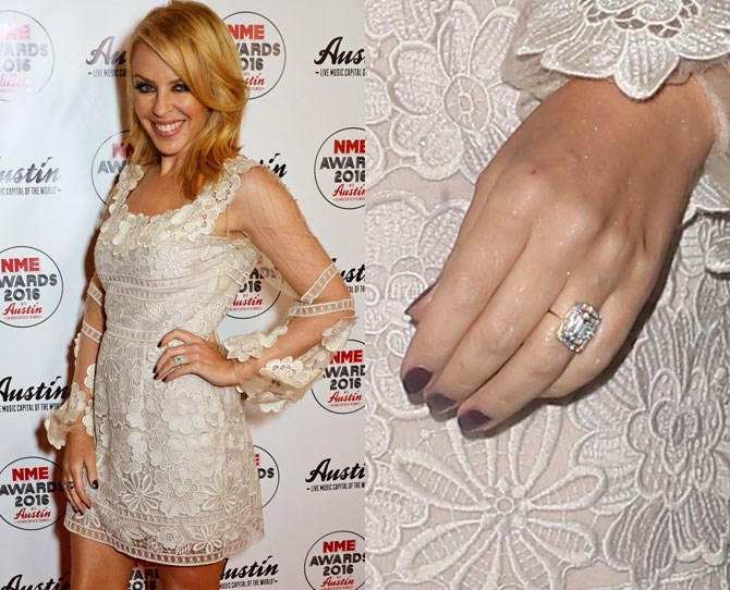 """Kylie Minogue and Joshua Sasse have FINALLY announced their engagement, with Kylie wearing one hell of an emerald cut rock on THAT finger at the NME Awards. When we found out that they announced the news with a very traditional notice in the [Daily Telegraph](http://www.telegraph.co.uk/news/celebritynews/12165675/Kylie-Minogue-announces-engagement-to-Joshua-Sasse-in-The-Daily-Telegraph.html