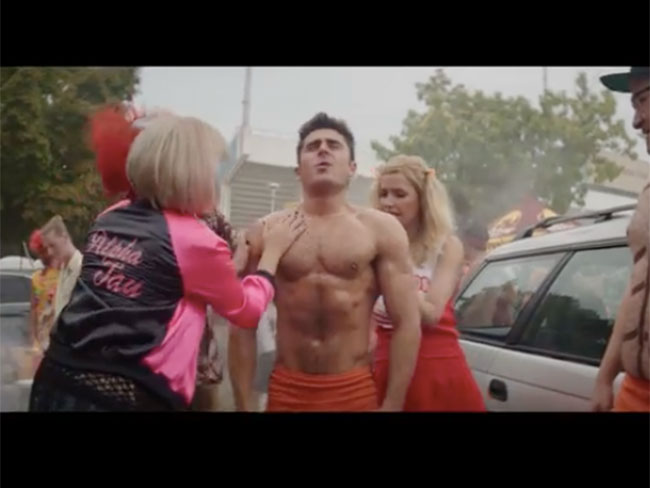 Zac Efron getting rubbed down with oil in the trailer for Neighbours 2 is hot AF