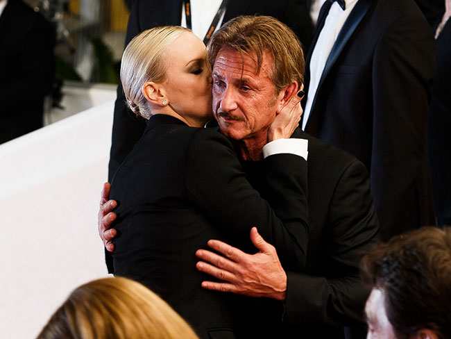 This moment between Charlize Theron and Sean Penn on the Cannes red carpet is too much for words