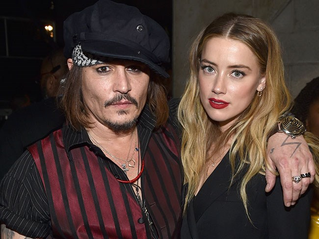 Amber Heard reportedly threatened to blackmail Johnny Depp before making domestic violence allegations, according to Doug Stanhope