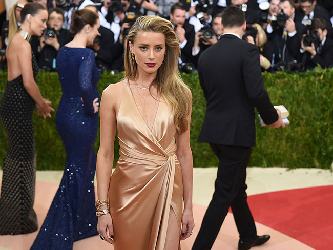 "Amber Heard releases statement to shut down ""relentless attacks"" and ""outright lies"""