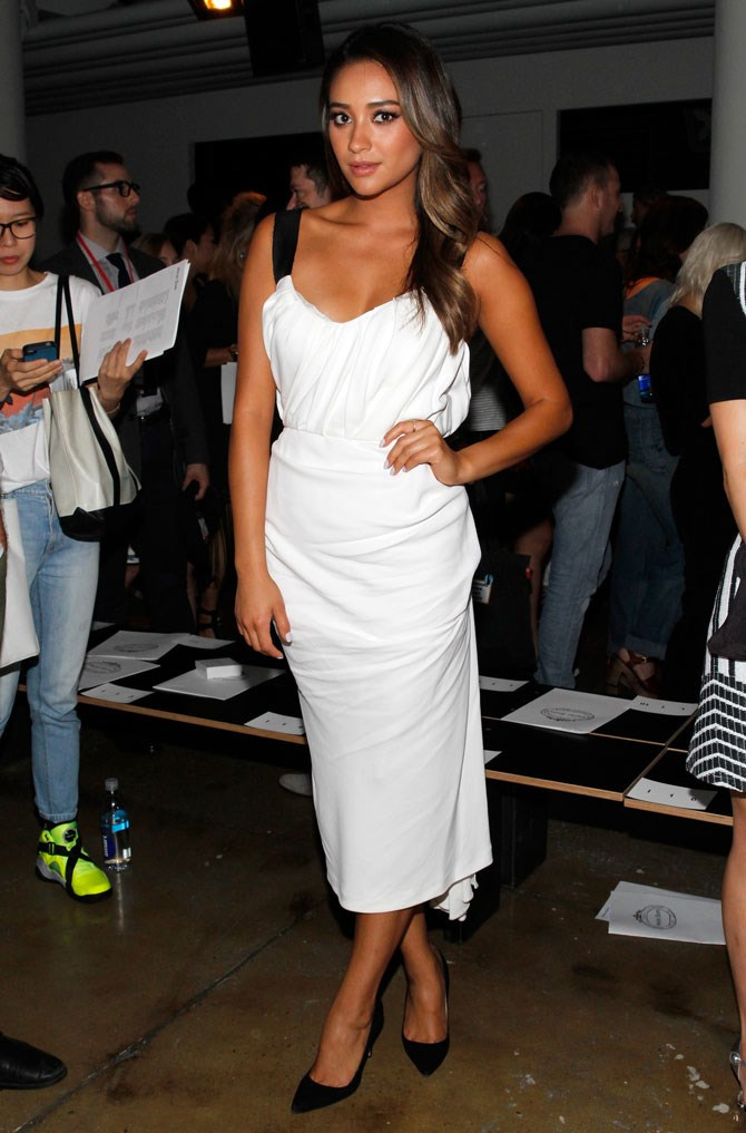 Getting in on some FROW action at Fashion Week, Shay totally looked the fashionista part in this gorgeous white midi dress.