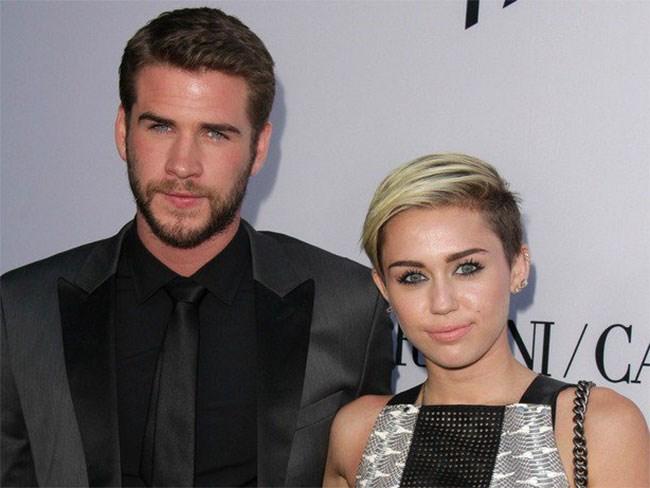 Miley Cyrus shares the most adorb pic of Liam Hemsworth & his pooch : Cosmopolitan