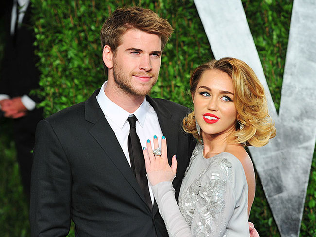 Miley Cyrus is wearing a diamond studded gold ring