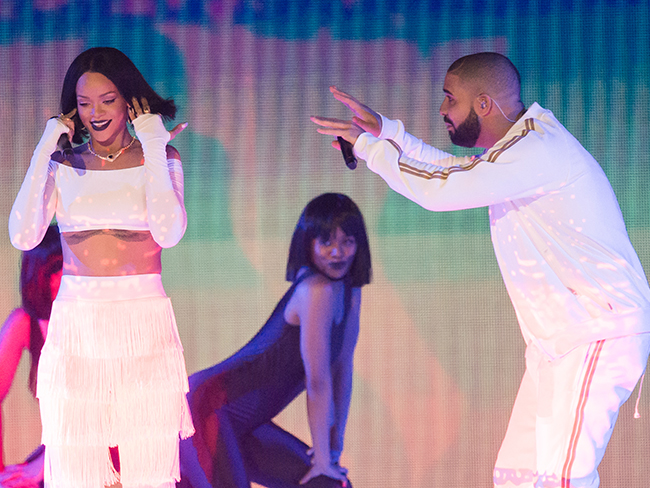 The internet responds *brilliantly* to that billboard Drake bought Rihanna