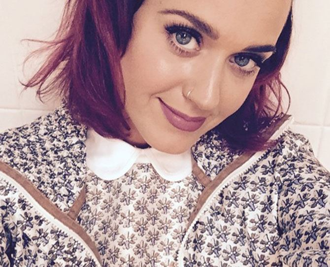 """OOTD school girl raincoat vibez."" She's done it again guys, Katy Perry has gone back to her, er, rainbow roots with this festive hue of red. LOVE."