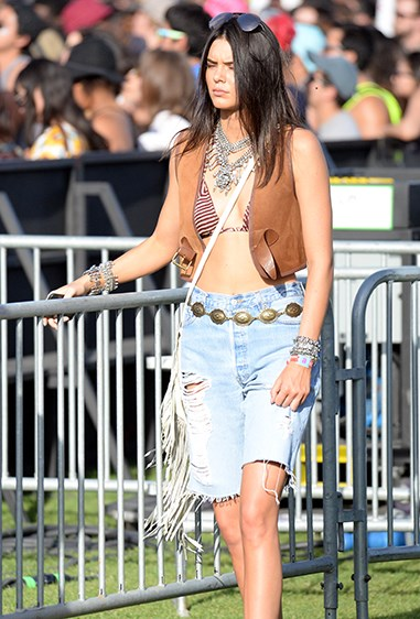 We think Kendall Jenner's cut-off jeans and cowboy-inspired vest was def #OOTD on day one of the festival.