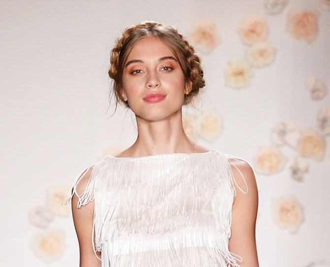**Whimsical and girly** Dreamy soft shades of pink and loose milk maid braids were the main focus at the LC Lauren Conrad show. Channel the romance of the 70s with gorgeous gold shimmery lids and rosy pink lips. #STUNNER
