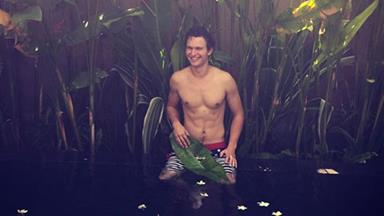Ansel Elgort is on holiday and wants to show you his abs