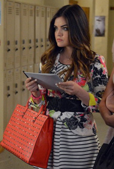 When Aria clashed stripes with fluoro florals and topped it off with a studded, orange bag. Oh, and a waist belt.