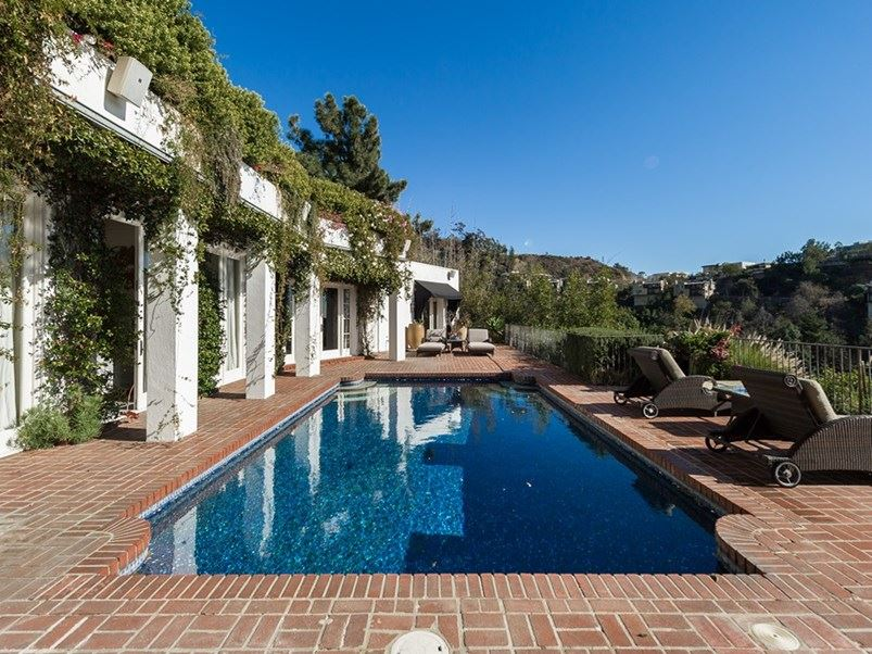 Just look at the pool. We're certain Freddie Reign will appreciate.   [Via The Agency](http://www.theagencyre.com/for-lease/1896-rising-glen-road-hollywood-hills/)