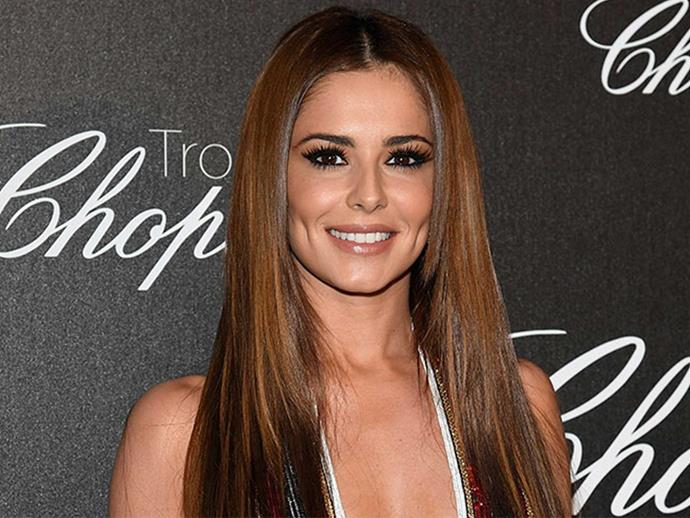 Cheryl looks more pregnant than ever in oversized sweater