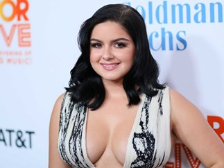 Ariel Winter walks the red carpet with boyfriend Levi Meaden