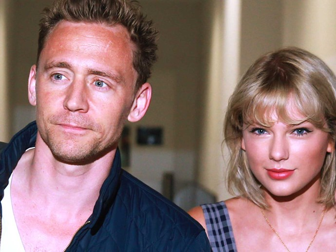 Tom Hiddleston jogs back Taylor Swift art on the street