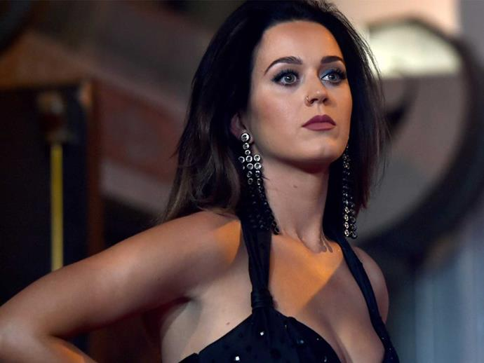 Katy Perry has a gold Nike tick on her tooth