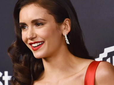 Nina Dobrev was caught kissing someone in an elevator at the Golden Globes after party