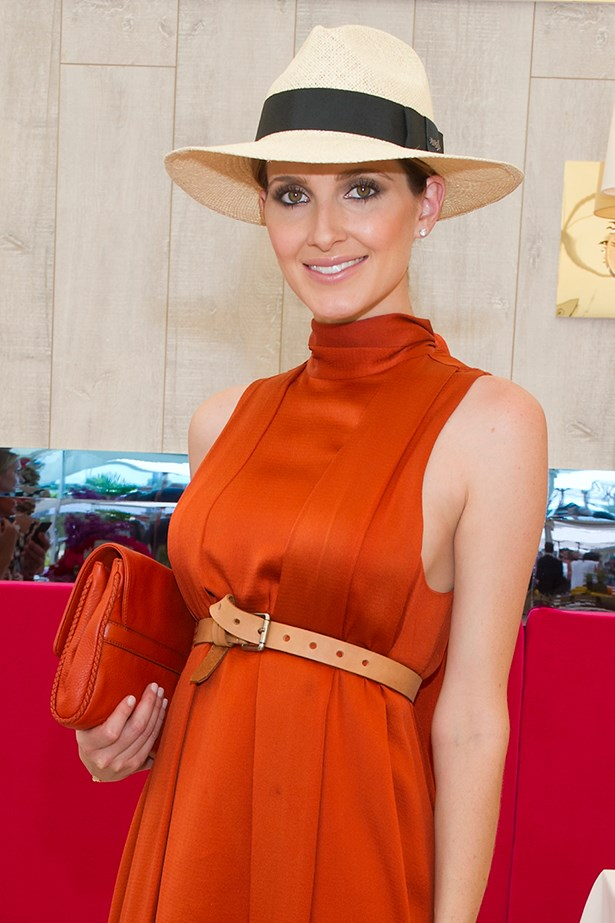 Kate Waterhouse demonstrates that a sharp-brimmed fedora is best worn without the distraction of hair. Pull strands into a low bun at the nape of your neck, or if you want to be really slick make a higher bun and hide hair completely.