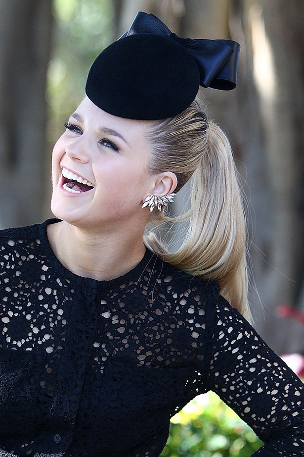 Emma Freedman gets it right by pairing her bow-topped headpiece with a sleek high pony.
