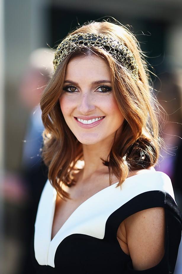 Proving she really is racing royalty, Kate Waterhouse works an embellished headband with the perfect wavy lob.