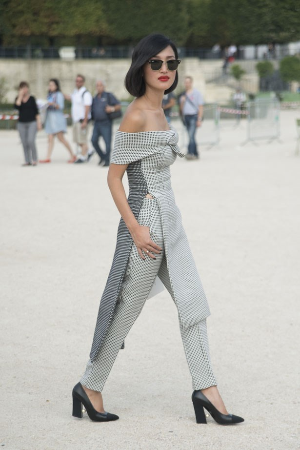 Playing with proportion at Paris SS14 Fashion Week, Nicole stood out from the front row pack in this tunic-over-trousers combo.