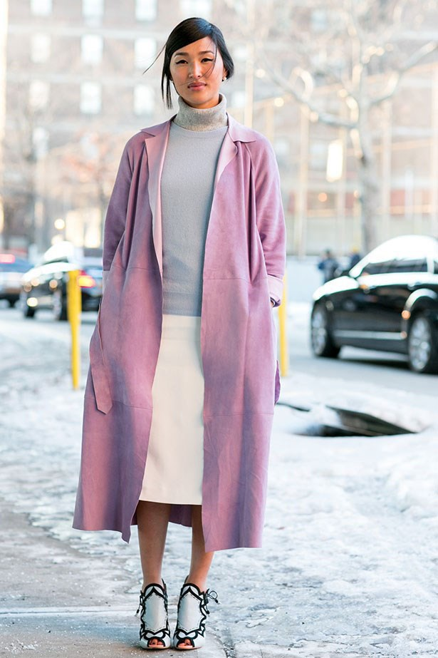 Showing dedication to her game: Not even an icy day at New York AW14 Fashion Week can deter Nicole from a bare leg.