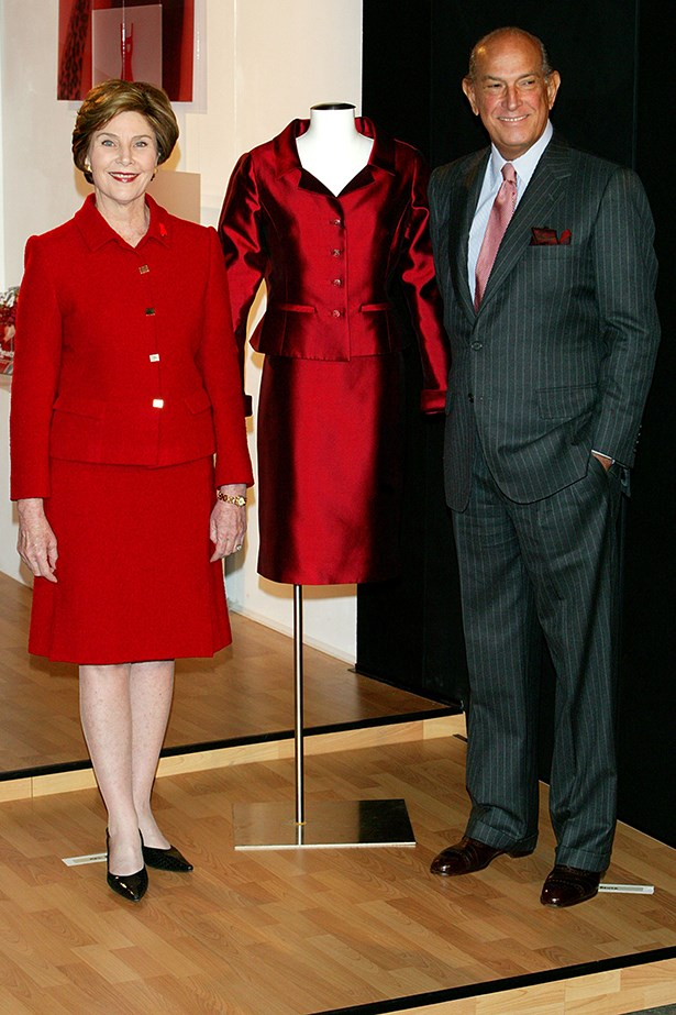 Laura Bush and Oscar de la Renta attend a ceremony unveiling an Oscar de la Renta dress donated to the Spring Fashion 2004 Heart Of Truth Campaign
