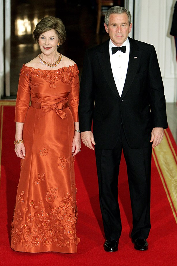 First Lady Laura Bush, wearing Oscar de la Renta, with her husband, President George Bush, at an event at the White House in 2005