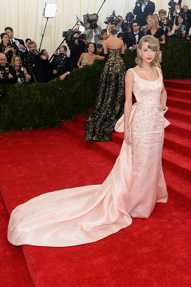 """My all-time favourite designer has passed away. Oscar, it was an honour to wear your creations and to know you. In loving memory."" @taylorswift on Twitter <br><br> The songstress wears an Oscar de la Renta gown to the 2014 Met Gala"