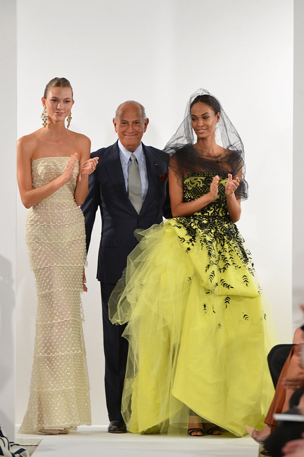 """Que en Paz descanses Oscar de la Renta. You will forever live in all of our hearts, thank you for all the great memories and moments. It was an honor to work with you and be in your presence #RIP #ODLR."" @joansmalls on Instagram <br><br> Model Joan Smalls with Karlie Kloss and Oscar de la Renta closing his Spring/Summer 2014 runway show"