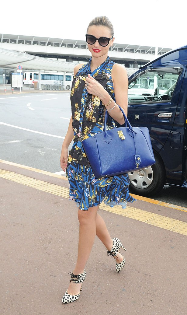 Killer shoes, tick. Bold bag, tick. Printed frock, tick. It's the MK triple threat.