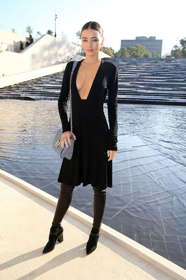 MK looks chic, even when showing acres of cleavage thanks to her long-sleeved frock, covered pins and slicked-back hair.