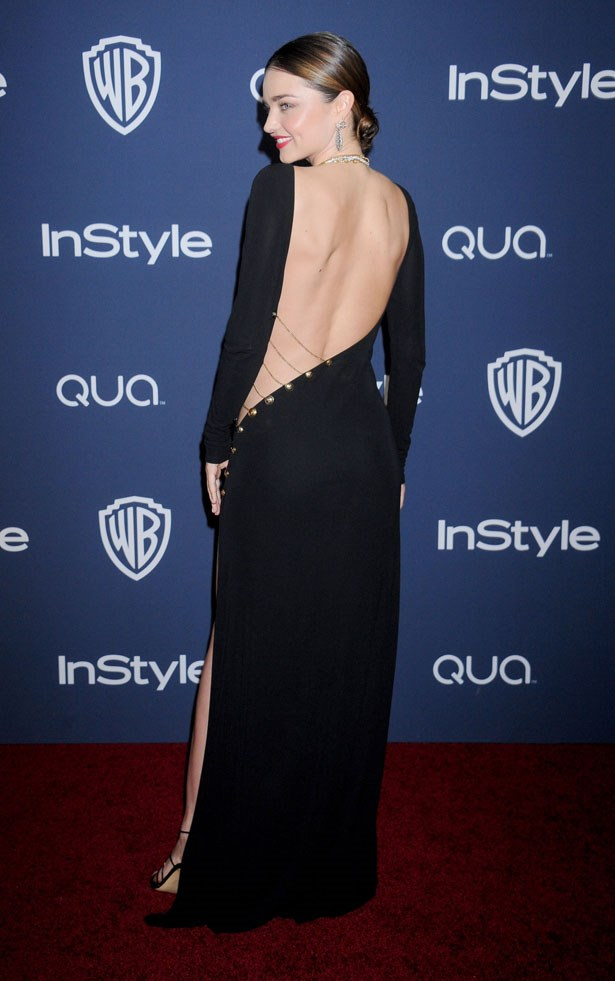 A dramatic, backless dress proves to be a head-turner on the red carpet.