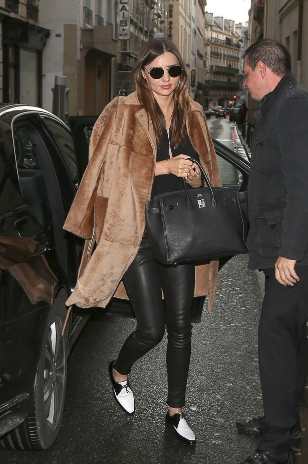 Every girls needs a classic camel coat, and Miranda Kerr is no exception.