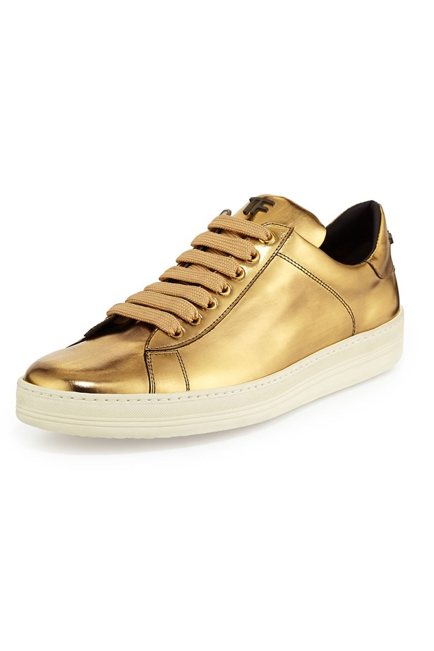 "Sneakers, approx $1,145, Tom Ford, <a href=""http://www.neimanmarcus.com/en-au/Tom-Ford-Mirror-Leather-TF-Low-Top-Sneaker-Gold/prod176420246_cat36450731__/p.prod?icid=&searchType=EndecaDrivenCat&rte=%252Fcategory.jsp%253FitemId%253Dcat36450731%2526pageSize%253D120%2526No%253D0%2526refinements%253D&eItemId=prod176420246&cmCat=product"">neimanmarcus.com</a>"