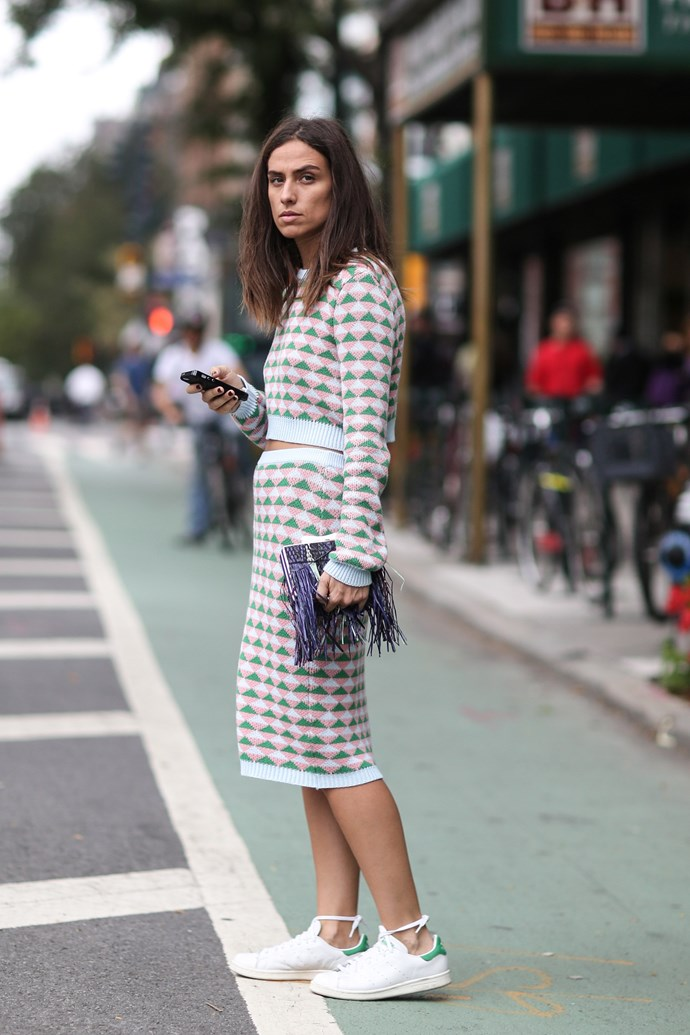 A prim two-piece looks modern when paired with a classic tennis shoe.