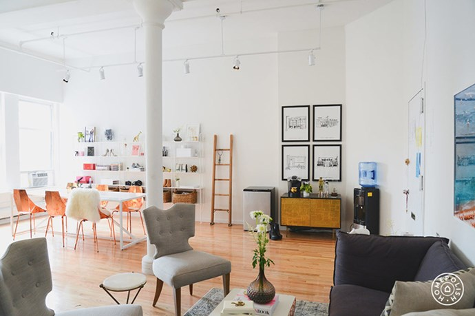 """All-white walls, high ceilings and timber floors act as the perfect neutral base for interesting furniture and graphic art. <br><br> <em>Image courtesy of <a href=""""https://www.homepolish.com/mag/the-new-man-repeller-office"""">Home Polish</a></em>"""