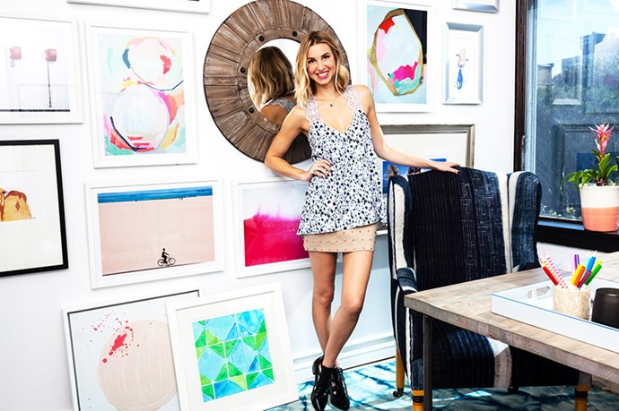 """Whitney Port shared her colour-filled office with <em>Domayne Home</em>. A collective wall hang sets an upbeat tone. <br><br> <em>Image courtesy of <a href=""""http://www.domainehome.com/whitney-port-office-one-kings-lane/"""">domaynehome.com</a></em>"""